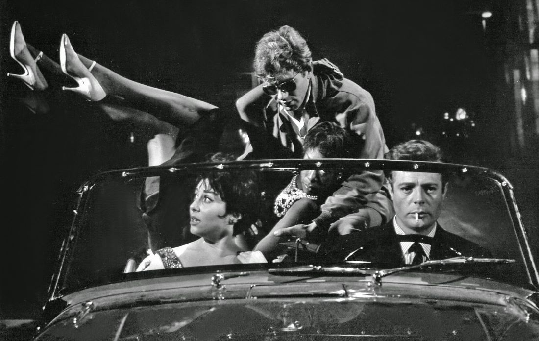 black and white photo of young people in a car