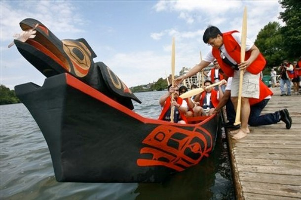 Members of the Tlingit Nation of Southeast Alaska board a dugout canoe, known as Raven Canoe.