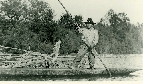 Man in a dugout freshwater canoe