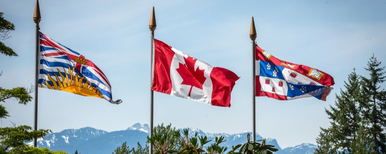 SFU, Canada, and BC flags on display