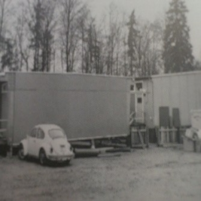 A historical photo of a temporary classroom structure