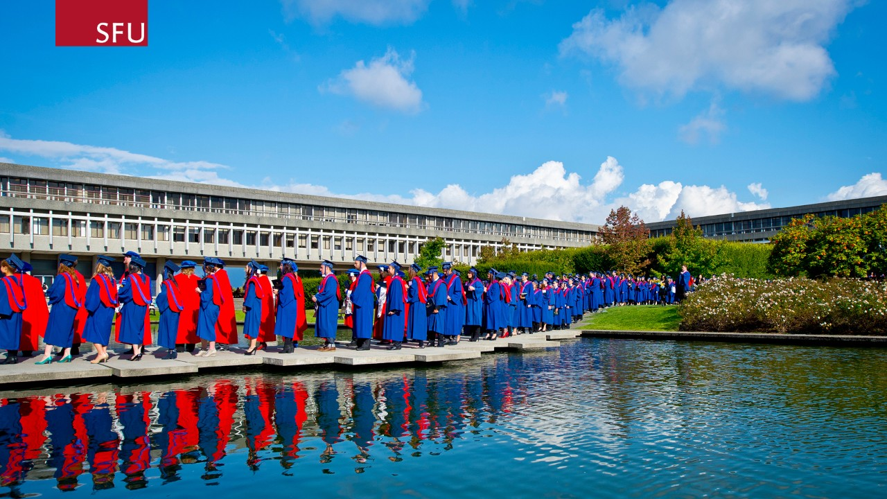 Zoom Background - Graduands crossing the AQ pond