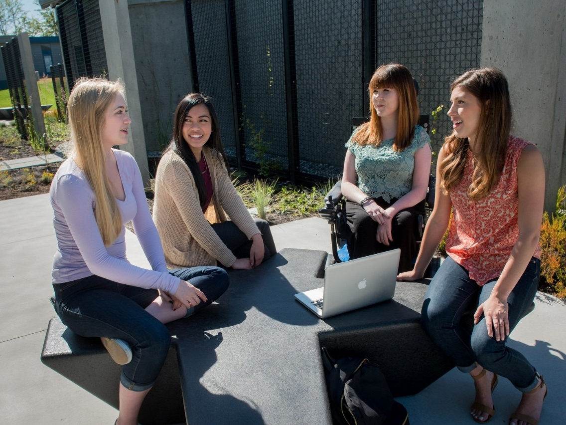 SFU students chatting outside at Burnaby campus