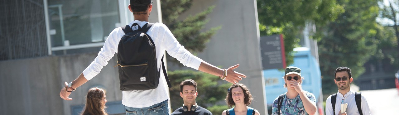 SFU resident greeting his new residence friends with open arms on move in day.