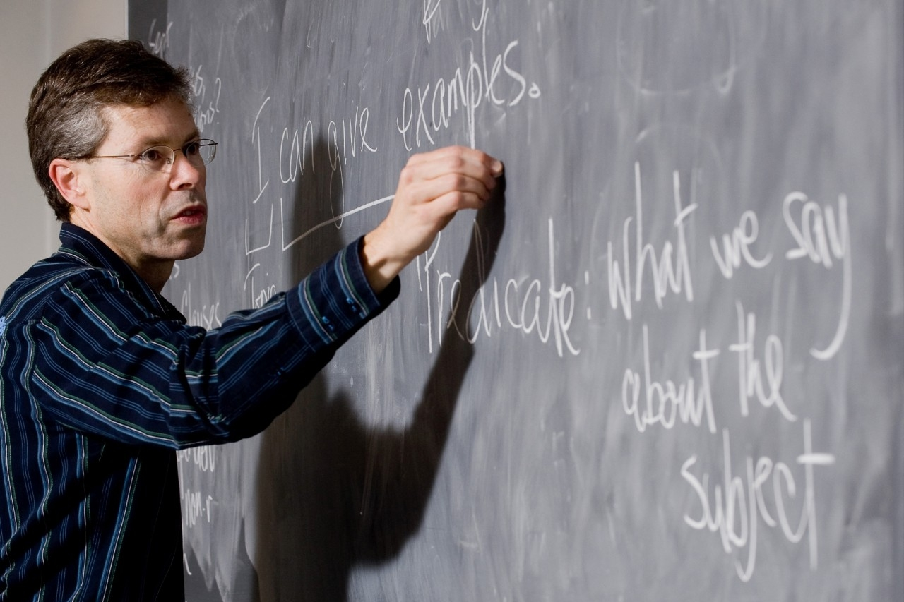 Instructor writing on chalkboard
