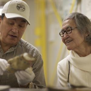 Photo: Albert Elias and Helen Gruben discuss beaded gloves at the Smithsonian Mu
