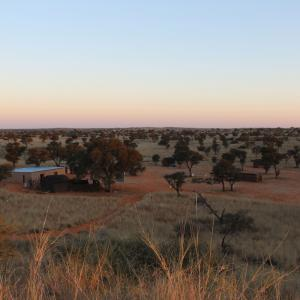 A sunset view of //Uruke Bush Camp Adventures. The land was returned to the +Kho