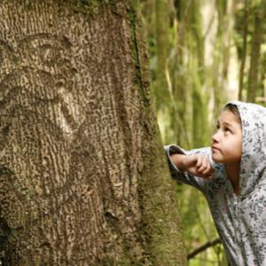 Moriori descendant, Nicole Whaitiri with a rākau momori (living tree carving) on