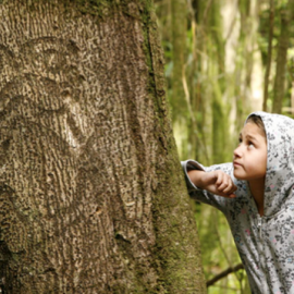 Moriori descendant, Nicole Whaitiri with a rakau momori (living tree carving) on