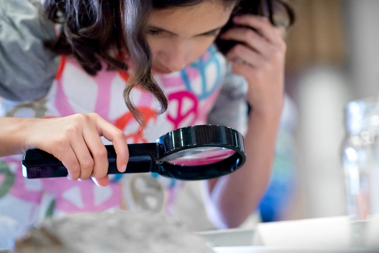 image of school age student with microscope