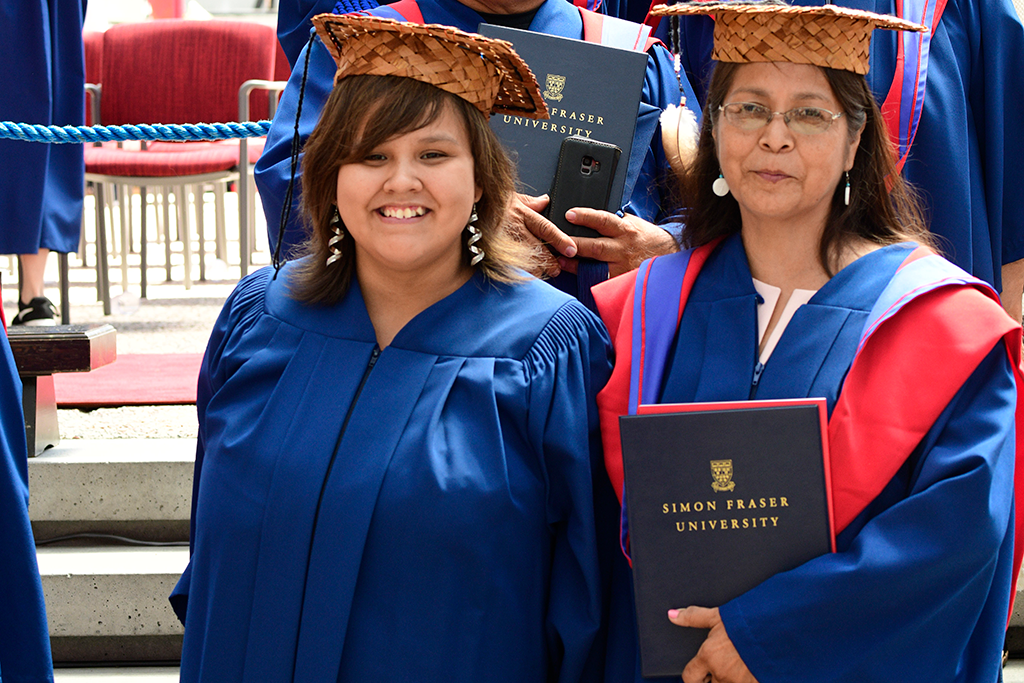 Martina Joe (left) received her Certificate for proficiency in a First Nations Language at convocation in 2019, alongside her aunt Bernadette Sam who received her master's degree. Photo: Cim MacDonald