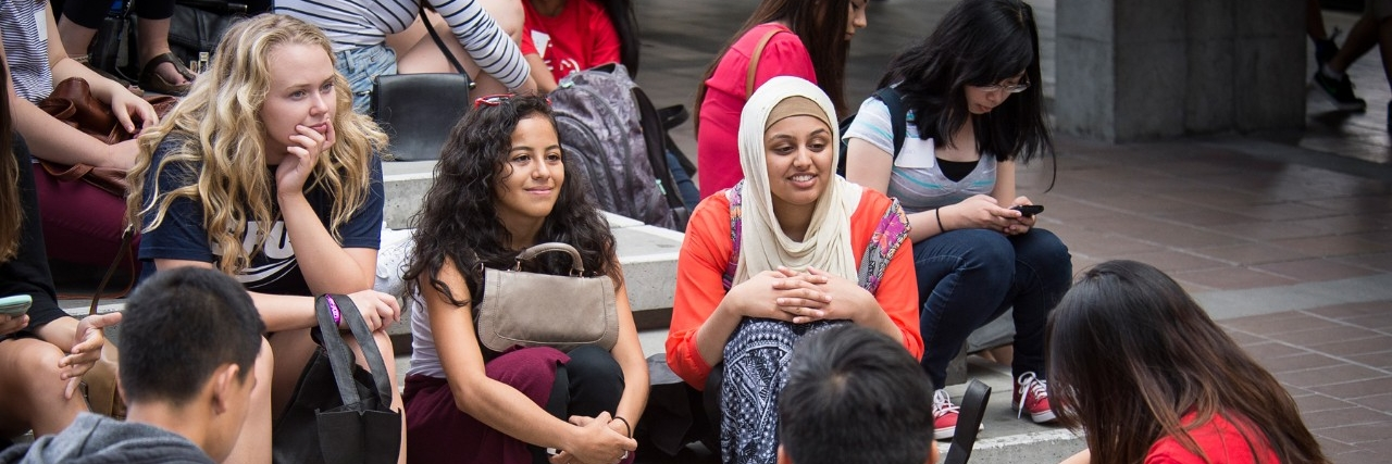 multicultural group of students gathered in Convocation Mall