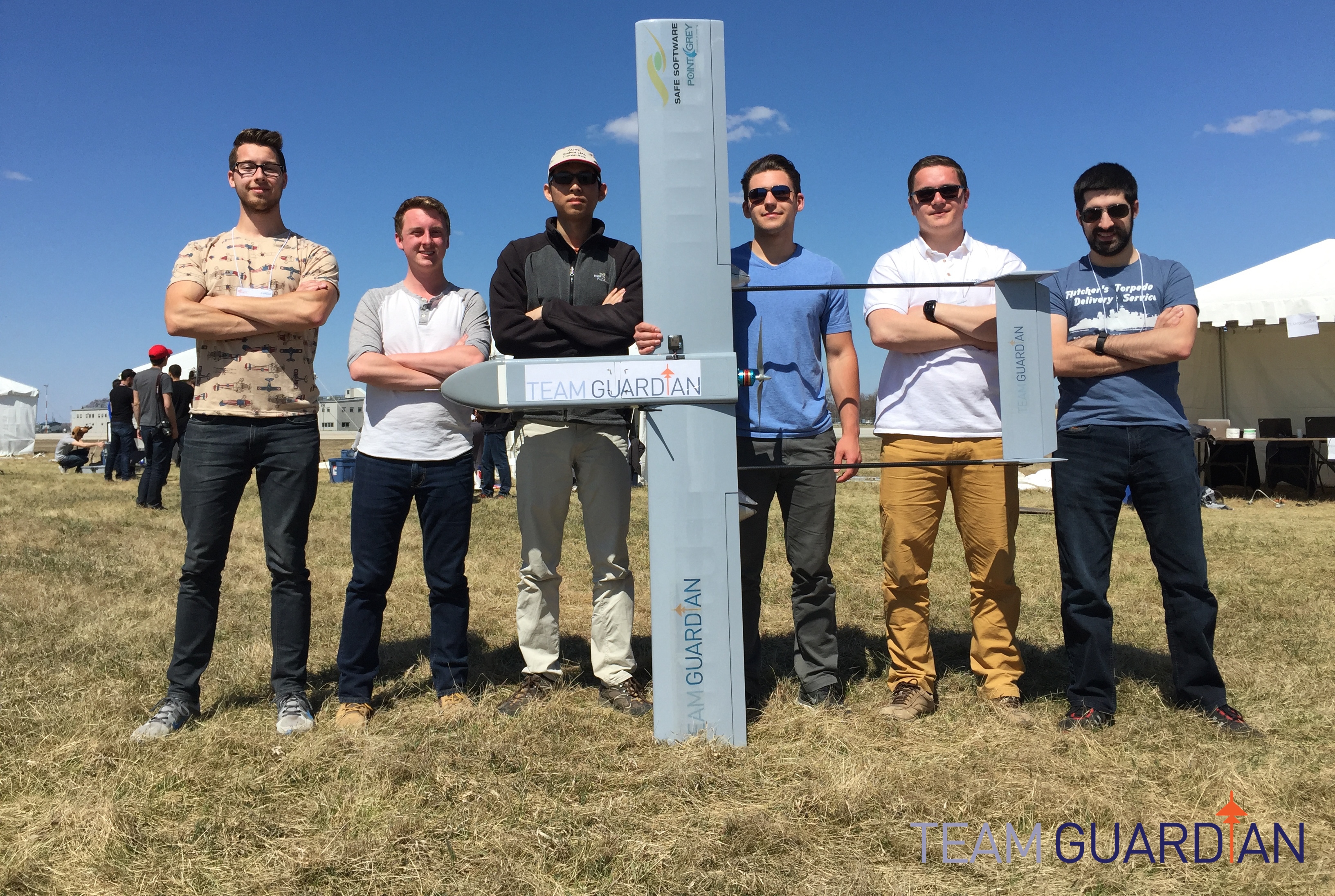 Team Guardian members Kris Gjernes, Richard Arthurs, Allan Lee, Mike Kontanist, Nikita Bazhanov and Josh Vazquez pose with Hugin, one of their unmanned aerial vehicles. Hugin was the team