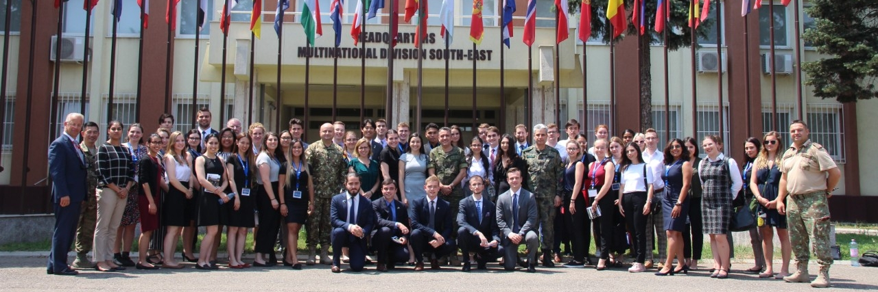 NATO Field School students in front of headquarters