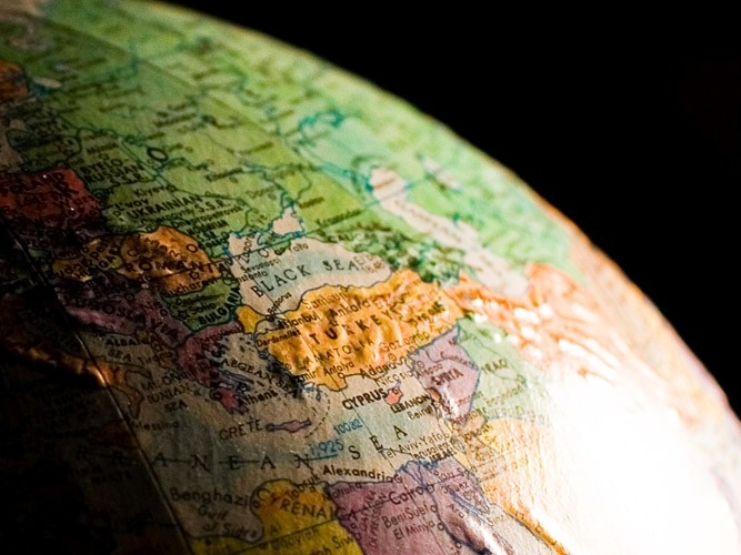 Close-up view of globe with dark background