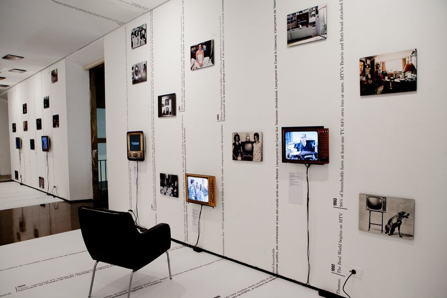 Judith Barry/Ken Saylor/Project Projects, From Receiver to Remote...channeling Spain, 2010. Installation with Spain/US timeline + TV programming, 91 photographs, 10 flat screens with audio, dimensions variable.