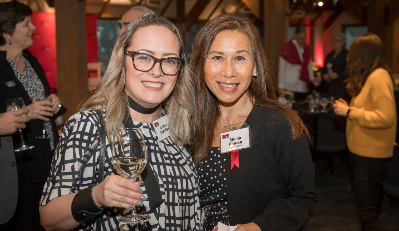 Staff Achievement Award winner Sheila Pineau (right) poses with Justine Crawford (left) at the SFU Awards Dinner on March 5, 2020.