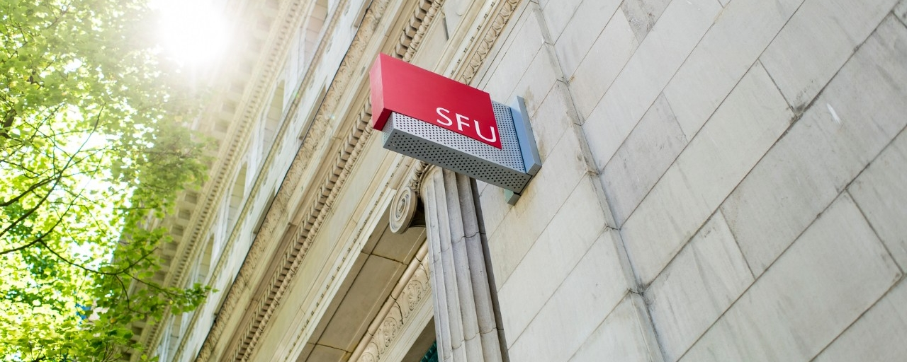 Photo of building with SFU sign