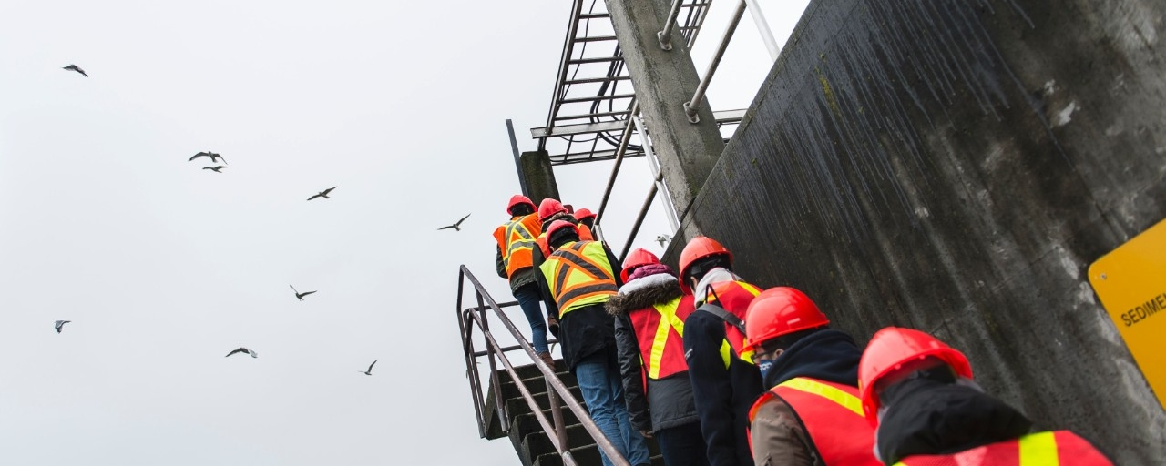photo of constructor workers walking up a set of stairs