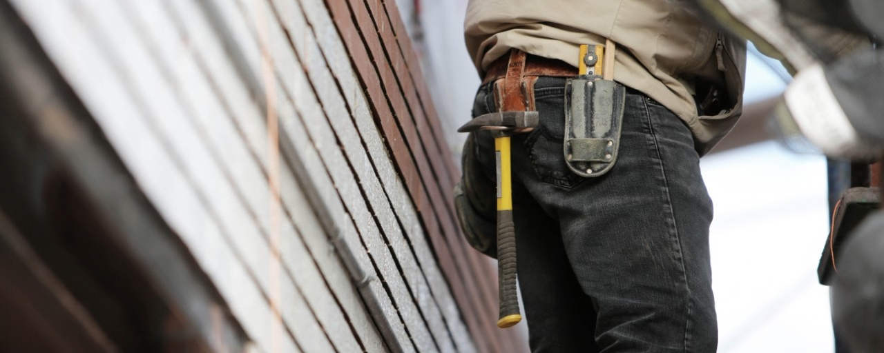 photo of construction worker with a tool-belt