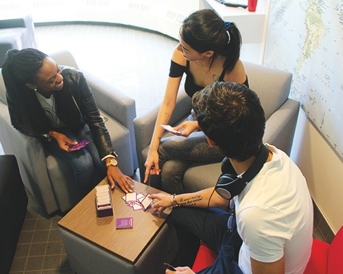 A group of SFU students playing cards