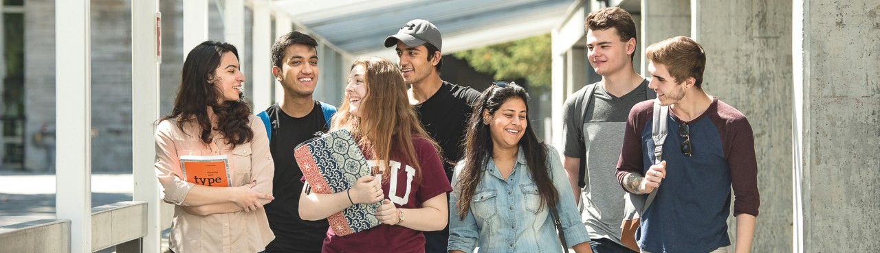 Group of excited new SFU residents heading towards week of welcome.